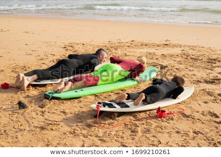 Grey-haired man laying in the sea Stock photo © photography33