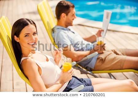 Homme potable jus d'orange piscine santé orange Photo stock © photography33