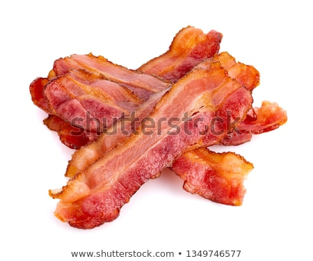 tasty sliced pork bacon isolated on white background stock photo © ozaiachin