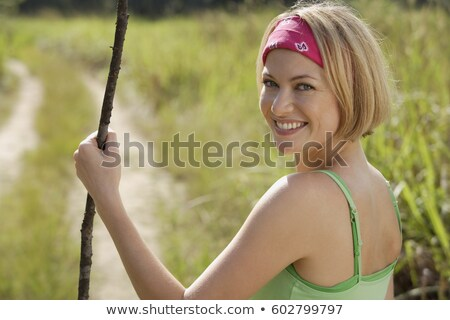 Happy woman looking over shoulder walking Stock photo © Ariwasabi