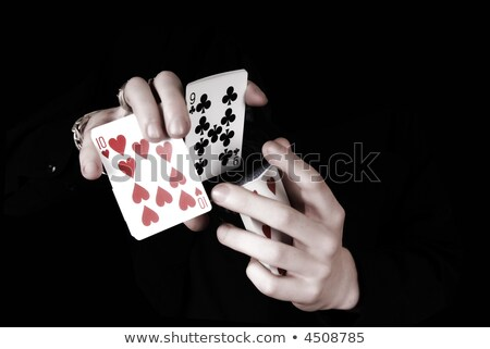 skillful magician with playing cards stock photo © photosebia