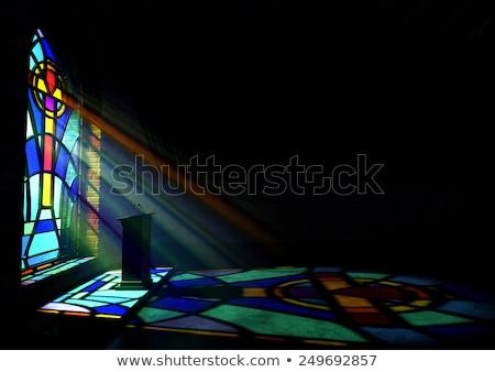 stained glass window crucifix illuminated light rays stock photo © albund