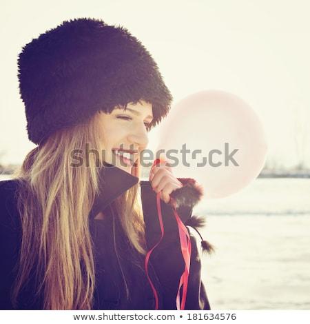 portrait of attractive girl in fur hat stock photo © pawelsierakowski