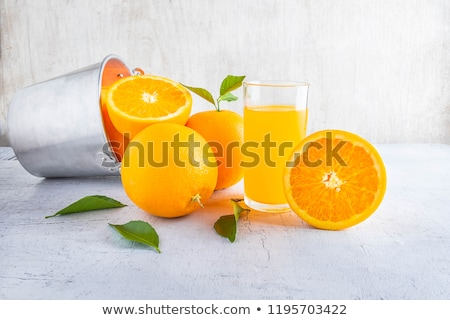 two glasses of orange juice and sliced ripe orange  Stock photo © evgenyatamanenko