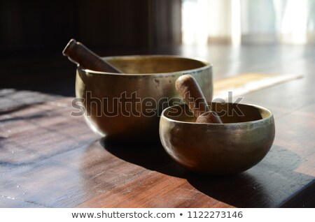 Practitioner  healing  with Tibetan singing bowls stock photo © TheFull360