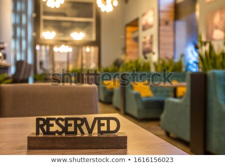 Reserved sign on a table Stock photo © IMaster