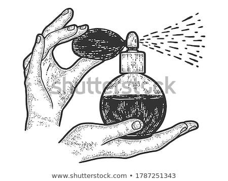 Stock photo: woman hands spraying perfume