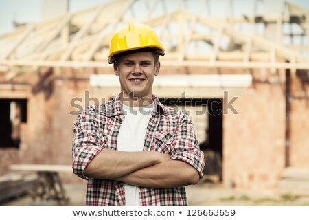 young male architect with arms crossed stock photo © stockyimages