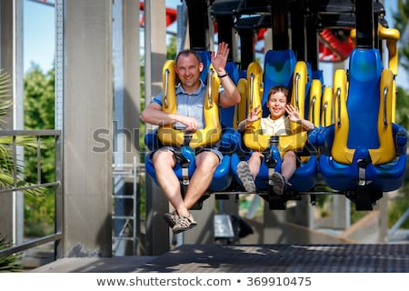 Man enjoying carousel ride with his son Stock photo © bmonteny