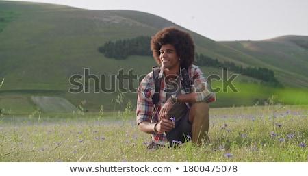 Moço campo de grama quadro acima sorridente câmera Foto stock © feedough
