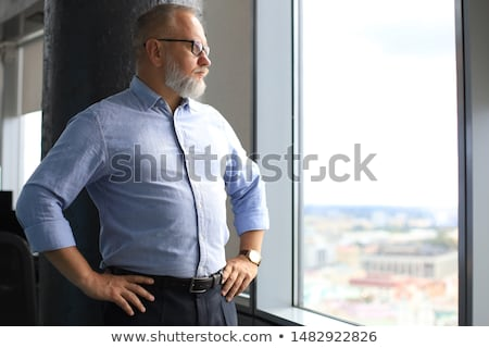 elegant business man looking away from the camera stock photo © feedough