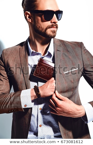 young elegant business man pulling his jacket stock photo © feedough