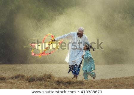 Muzułmanin · chłopca · Kania · asian · gry · dziedzinie - zdjęcia stock © tujuh17belas