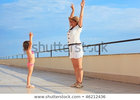 elderly woman and  little girl do morning exercise on veranda ne Stock photo © Paha_L