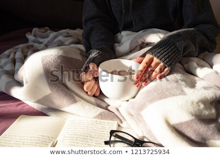 Stock photo: Female writer drinking cup of coffee