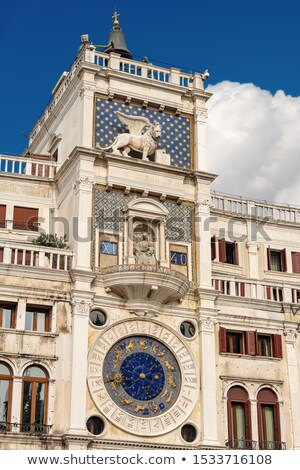 Winged lion on facede of the bell tower at San Marco square in V Stock photo © AndreyKr