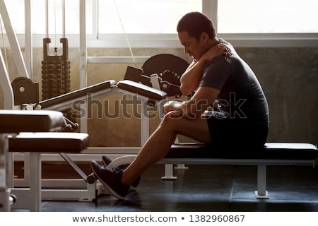 Strong bodybuilder with painful neck Stock photo © wavebreak_media