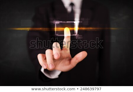 tech business person touching button with orange light beams con stock photo © ra2studio