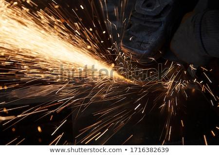Worker cutting iron with professional tool Stock photo © zurijeta