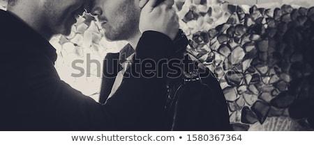 homoszexuális · pár · kéz · a · kézben · szivárvány · zászló · közelkép - stock fotó © dolgachov