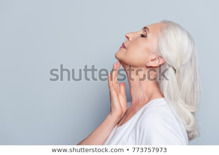 Beautiful middle aged woman with cream stock photo © svetography