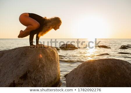 女性 クレーン ポーズ ヨガのポーズ 瞑想 日没 ストックフォト © photocreo