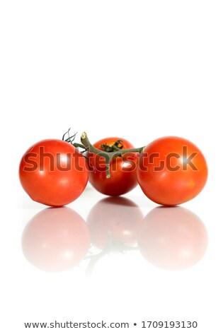 Ripe Red Tomato on Reflective White Stock photo © ambientideas
