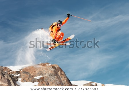 saltar · esquiador · estilo · libre · alto · montanas · nubes - foto stock © gravityimaging
