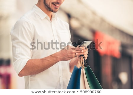 Foto stock: Homem · sacos · feliz · compras