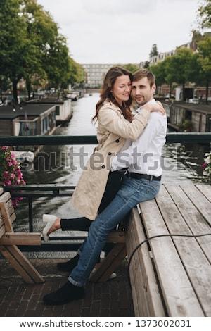Guy with a girl standing on bridge Stock photo © tekso