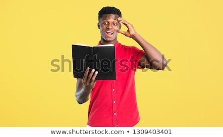 young african american man reading magazine stock photo © rastudio