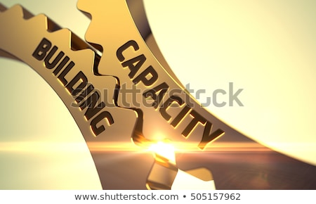 Capacidade edifício dourado engrenagens 3D mecanismo Foto stock © tashatuvango