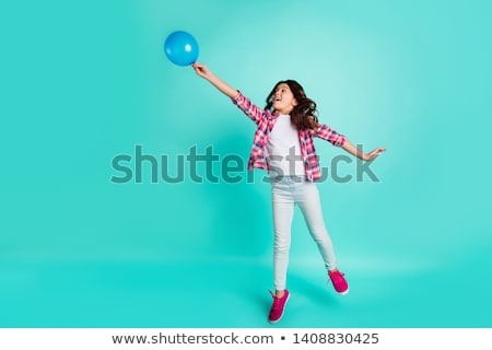 Full length portrait of a cheery little girl Stock photo © deandrobot