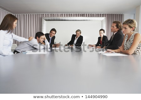 Businessman sleeping on conference table Stock photo © IS2