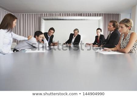 бизнесмен спальный конференции таблице человека улыбаясь Сток-фото © IS2