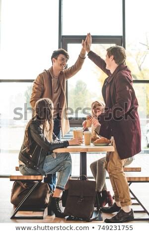 Uśmiechnięty człowiek rogalik kawiarnia portret żywności Zdjęcia stock © wavebreak_media