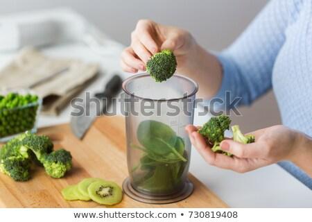 woman hand adding broccoli to measuring cup Stock photo © dolgachov