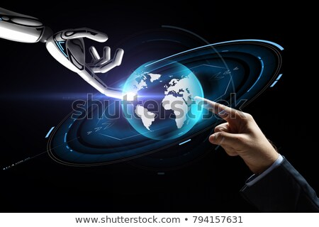 businessman and robot with virtual earth hologram stock photo © dolgachov