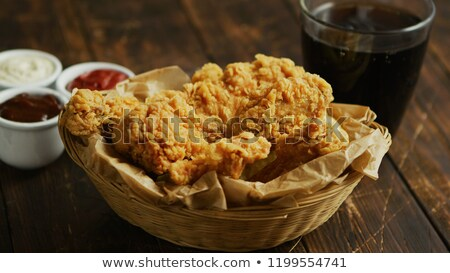 Fried chicken wings near sauces and drink Stock photo © dash