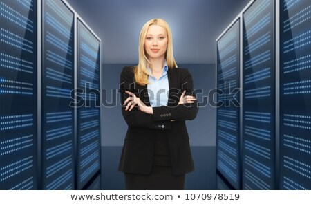 businesswoman or admin over server room background Stock photo © dolgachov