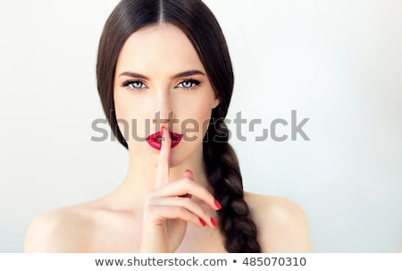 woman with red lipstick holding finger on mouth Stock photo © dolgachov