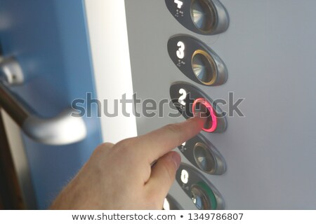 Man Pressing On Second Floor Elevator Button Stock photo © AndreyPopov