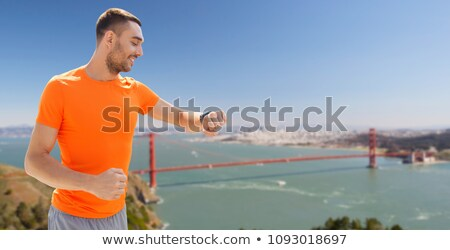 man with fitness tracker over golden gate bridge Stock photo © dolgachov