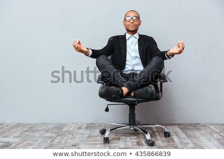 Afrika işadamı oturma ofis koltuğu iş adamları gülen Stok fotoğraf © dolgachov