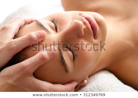therapist massaging womans head stock photo © andreypopov