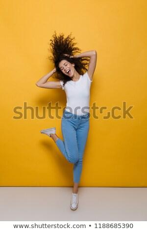 atlama · kız · kıvırcık · saçlı · güzel · yalınayak · üzerinde - stok fotoğraf © deandrobot
