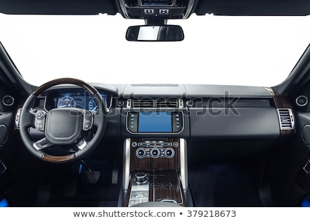 Modern luxury prestige car interior, dashboard, steering wheel. Black perforated leather interior. Stock photo © ruslanshramko