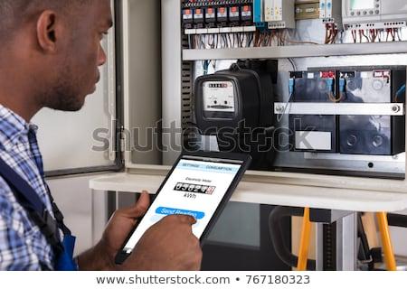 Stock photo: Male Technician Doing Meter Reading
