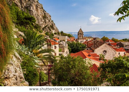 Town of Omis old stone mediterranean street and church view Stock photo © xbrchx