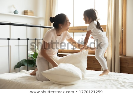 Two excited pretty girls wearing pajamas Stock photo © deandrobot
